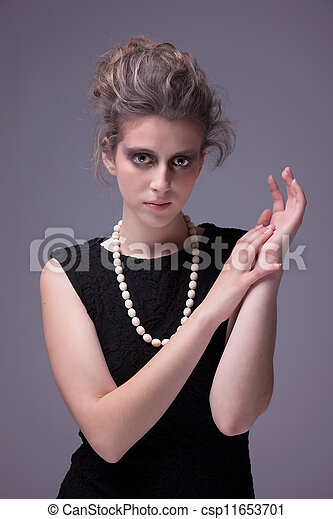beautiful young woman with elegant black dress, studio shot - csp11653701