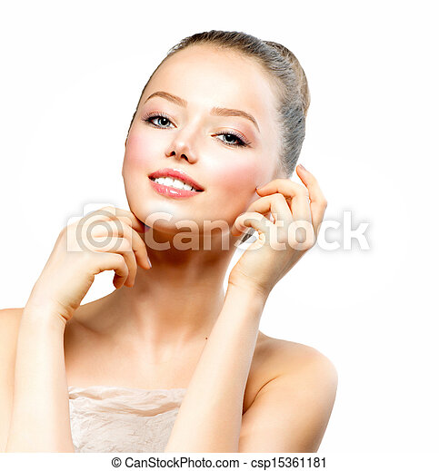 Beautiful Young Woman with Fresh Clean Skin touching her Face - csp15361181