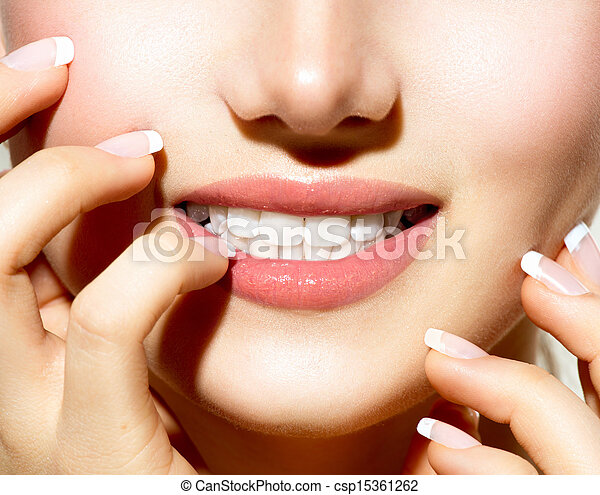 Beautiful Young Woman with Fresh Clean Skin touching her Face  - csp15361262