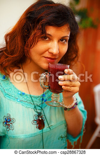 Beautiful Young Woman with Fruit smoothie - csp28867328