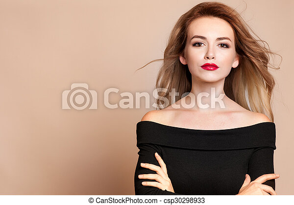 Beautiful young woman with long hair and jewelery. - csp30298933