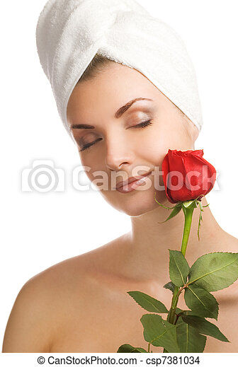 Beautiful young woman with red rose - csp7381034