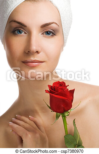 Beautiful young woman with red rose - csp7380970