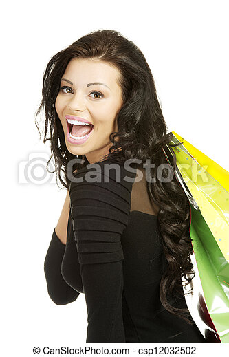 Beautiful young woman with shopping bags - csp12032502
