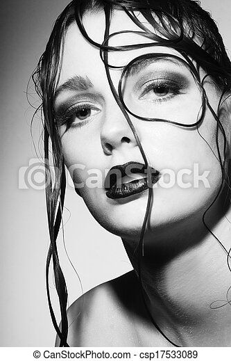 Beautiful young woman with wet hair - csp17533089