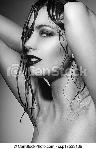 Beautiful young woman with wet hair - csp17533139