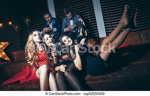 633c99a9237 Beautiful young women enjoying party and having fun at night club