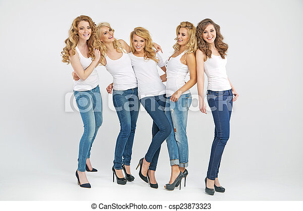 Beautiful young women posing together - csp23873323