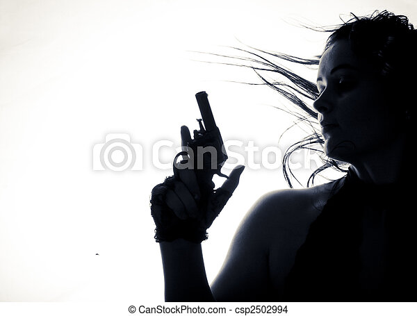 Beautiful young women with gun. Isolated. - csp2502994
