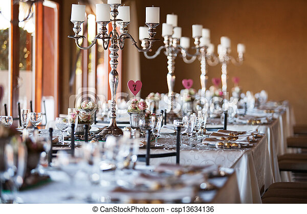 Beautifully decorated tables with candelabra at wedding reception, selective focus - csp13634136