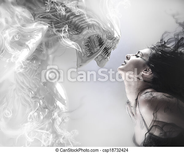 beauty and the beast, beautiful woman kissing a monster - csp18732424