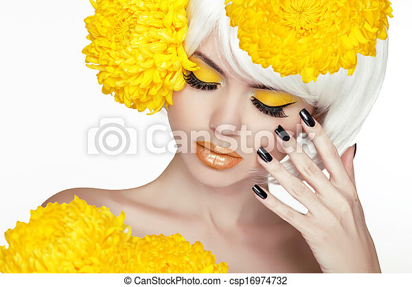 Beauty Blond Female Portrait with yellow flowers. Beautiful Spa Woman Touching her Face. Makeup and manicured nails. Perfect Fresh Skin. Isolated on white background - csp16974732