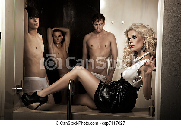 Beauty blonde woman and men in background - csp7117027