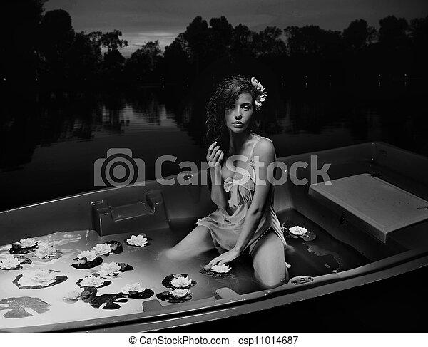 Beauty brunette in boat - csp11014687