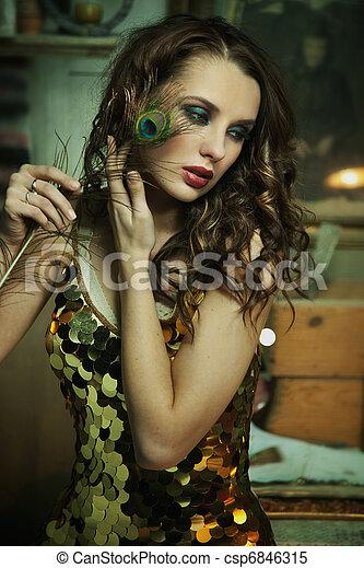 Beauty brunette in gold dress - csp6846315