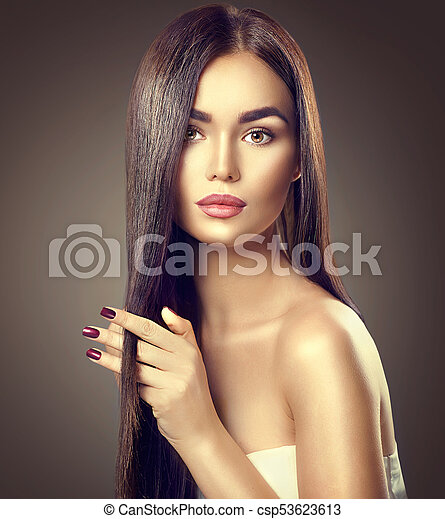 Beauty brunette model girl touching brown long healthy hair - csp53623613