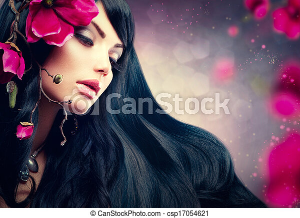 Beauty Brunette Model Girl with Big Purple Flowers in her Hair - csp17054621