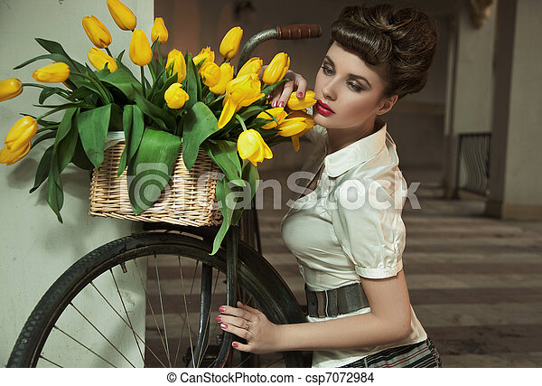 Beauty brunette with bunch of flowers - csp7072984