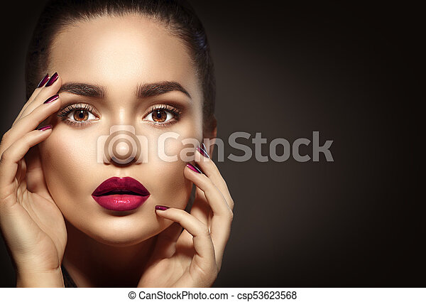 Beauty brunette woman with perfect holiday makeup - csp53623568