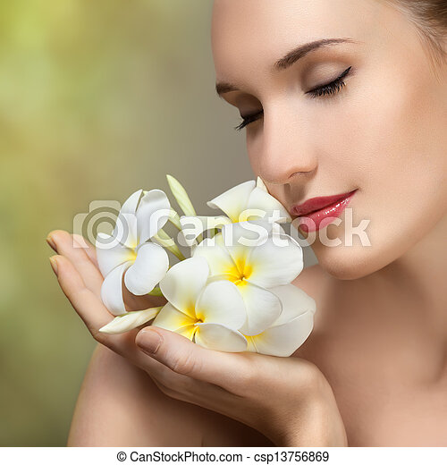 Beauty face of the young beautiful woman with flower. - csp13756869