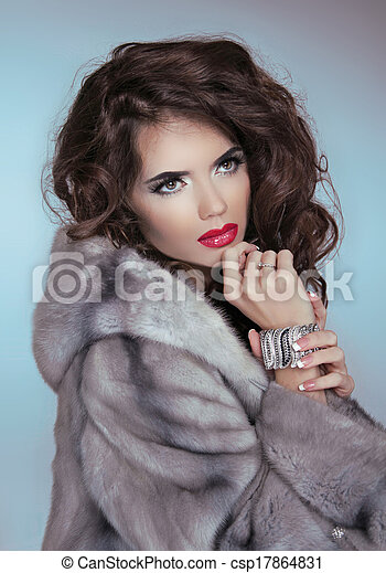 Stock Photography of Brunette woman with jewelry wearing luxury ...