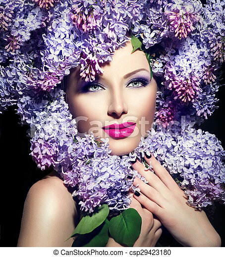 Beauty fashion model girl with lilac flowers hairstyle - csp29423180