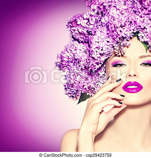 Beauty fashion model girl with lilac flowers hairstyle - csp29423759