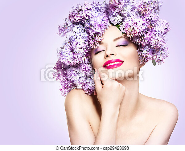 Beauty fashion model girl with lilac flowers hairstyle - csp29423698