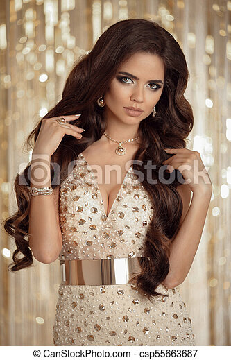 b25f1543528 Beauty fashion portrait of sexy girl in golden dress. elegant brunette with  long wavy hair and evening makeup