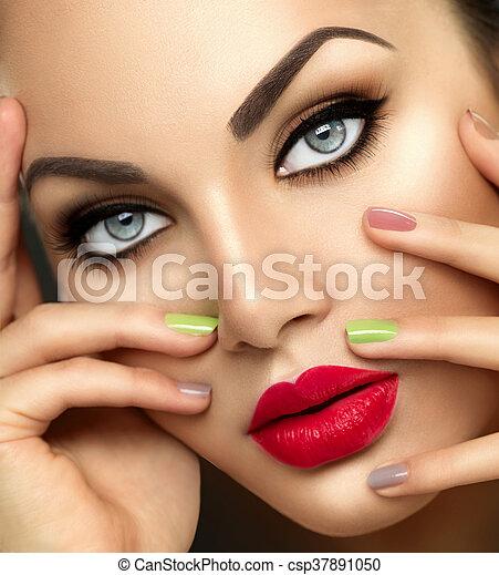 Beauty fashion woman with vivid makeup and colorful nailpolish - csp37891050