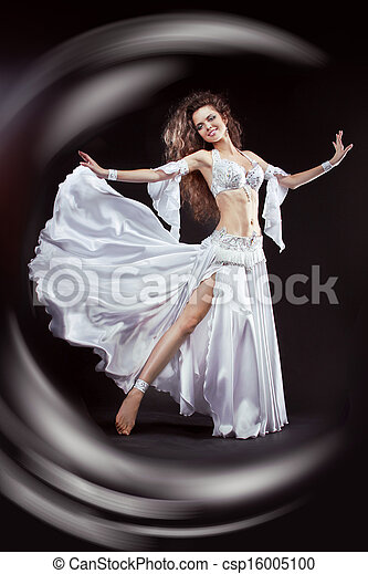 Beauty Girl belly dancer in white suit oriental dance in motion isolated on black background - csp16005100