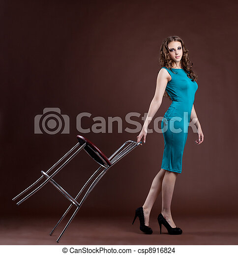 Beauty girl walk with bar chair - csp8916824