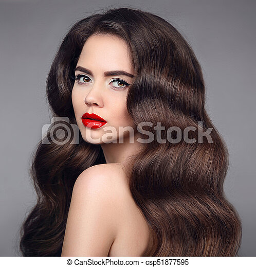 Beauty Hair. Brunette Girl Portrait With Red Lipstick And Long Shiny Wavy  Hair. Beautiful Model With Healthy Hairstyle Isolated On Studio Dark  Background.
