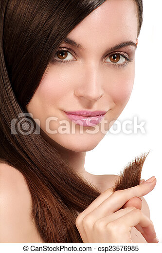 Beauty model showing perfect skin and long healthy brown hair - csp23576985