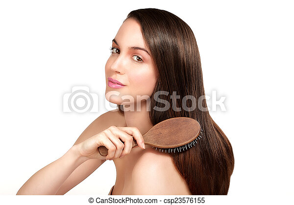 Beauty model showing perfect skin and long healthy brown hair - csp23576155