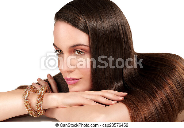 Beauty model showing perfect skin and long healthy brown hair - csp23576452