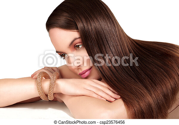 Beauty model showing perfect skin and long healthy brown hair - csp23576456