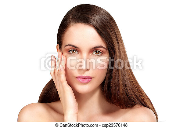 Beauty model showing perfect skin and long healthy brown hair - csp23576148
