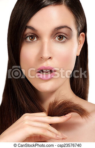 Beauty model showing perfect skin and long healthy brown hair - csp23576740