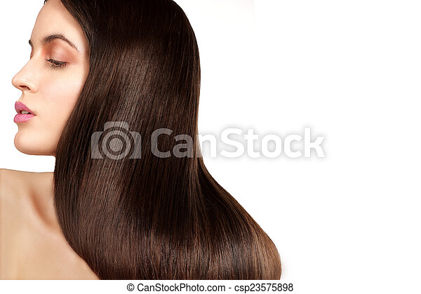 Beauty model showing perfect skin and long healthy brown hair - csp23575898