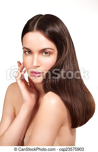Beauty model showing perfect skin and long healthy brown hair - csp23575903