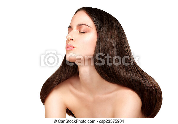 Beauty model showing perfect skin and long healthy brown hair - csp23575904