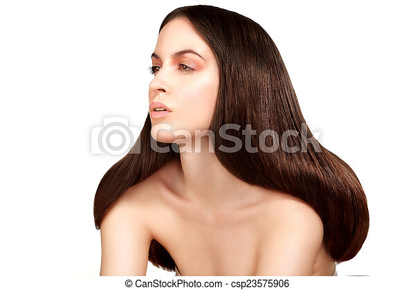 Beauty model showing perfect skin and long healthy brown hair - csp23575906