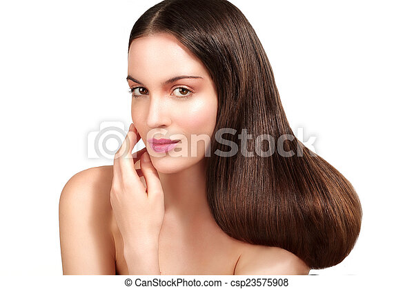 Beauty model showing perfect skin and long healthy brown hair - csp23575908