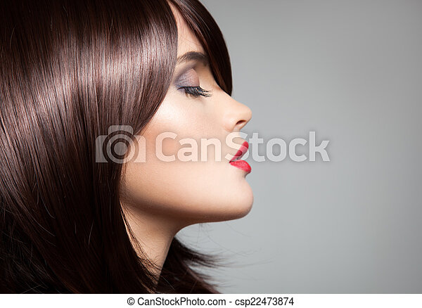 Beauty model with perfect long glossy brown hair. Close-up portr - csp22473874