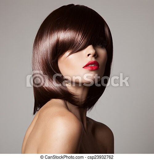 Beauty model with perfect long glossy brown hair. Close-up portr - csp23932762