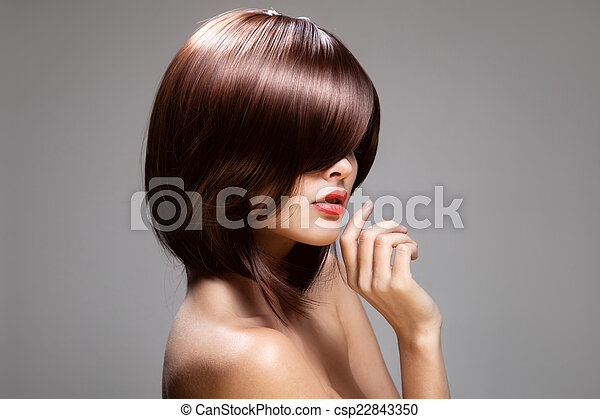 Beauty model with perfect long glossy brown hair. Close-up portr - csp22843350