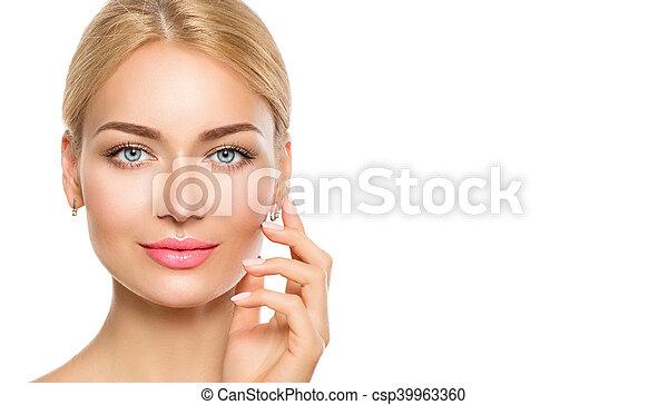 Beauty model woman face. Beautiful spa girl touching her face - csp39963360