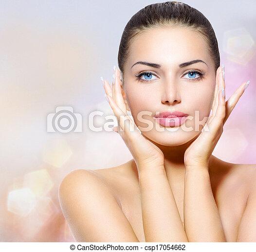 Beauty Portrait. Beautiful Spa Woman Touching her Face - csp17054662