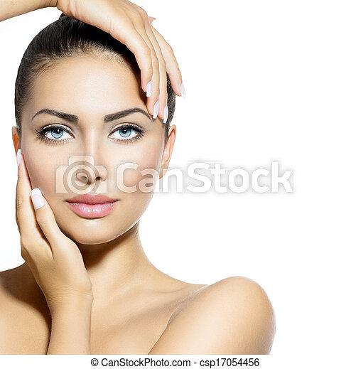 Beauty Portrait. Beautiful Spa Woman Touching her Face - csp17054456